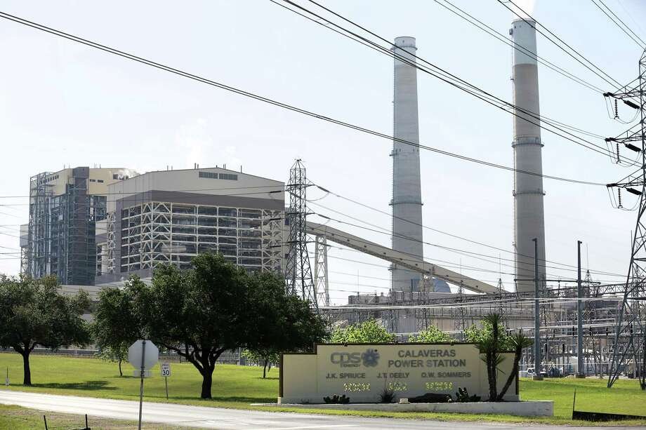 The J.K. Spruce plant, left, is seen at the entrance to the CPS Energy Plants, on Wednesday, April 25, 2018. The Deely plant shut down a year ago. Photo: San Antonio Express-News / ©2018 San Antonio Express-News