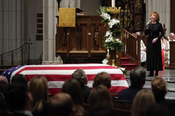 """Reba McEntire sings """"The Lord's Prayer"""" during a funeral service for former President George H.W. Bush on Thursday in Houston. As with Sen. John McCain, Bush's passing brought out tribalism in some quarters."""