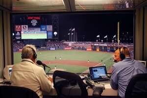 Announcers Ken Korach, left, and Vince Cotroneo broadcast live during Game 2 of the Bay Bridge series between the San Francisco Giants and the Oakland A's March 28, 2014 at AT&T Park in San Francisco, Calif.