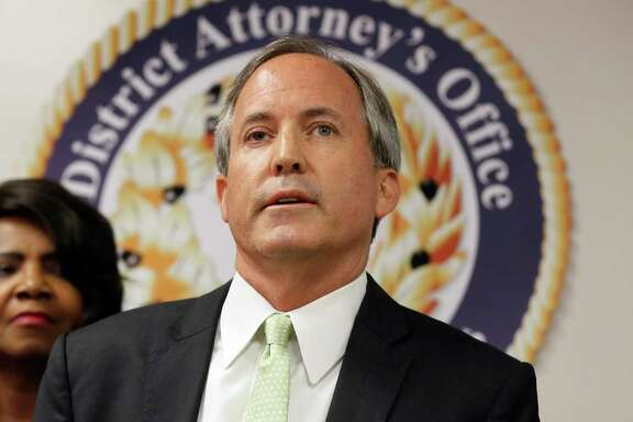 Texas Attorney General Ken Paxton, shown here last year in Dallas, has said he is suing the city of San Antonio for allegedly violating the law created by Senate Bill 4. A reader suggests some irony.