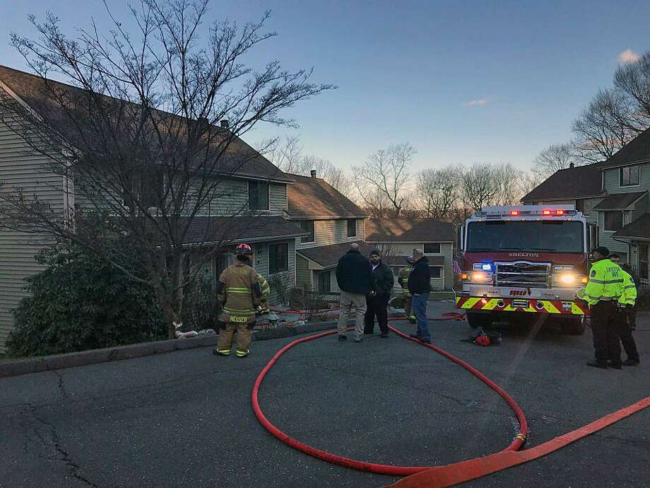 Around 2:15 p.m., fire units were sent to a two-story condo complex on Coram Road, between Connecticut and Fairfield avenues, in Shelton, Conn., for a report of a structure fire on Dec. 7, 2018. Photo: Contributed Photo / Shelton Echo Hose Fire Company / Contributed Photo / Connecticut Post Contributed