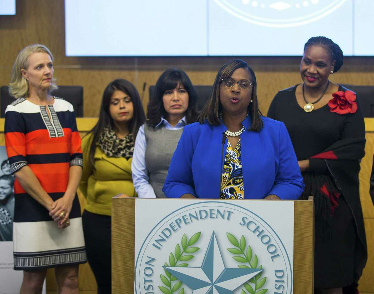 Houston Independent School District trustees (LtoR) Sue Deigaard, Elizabeth Santos, Diana Dávila and Wanda Adams listen as Grenita Lathan addresses the media during a press conference at the Hattie Mae White Educational Support Center, Monday, Oct. 15, 2018 in Houston.
