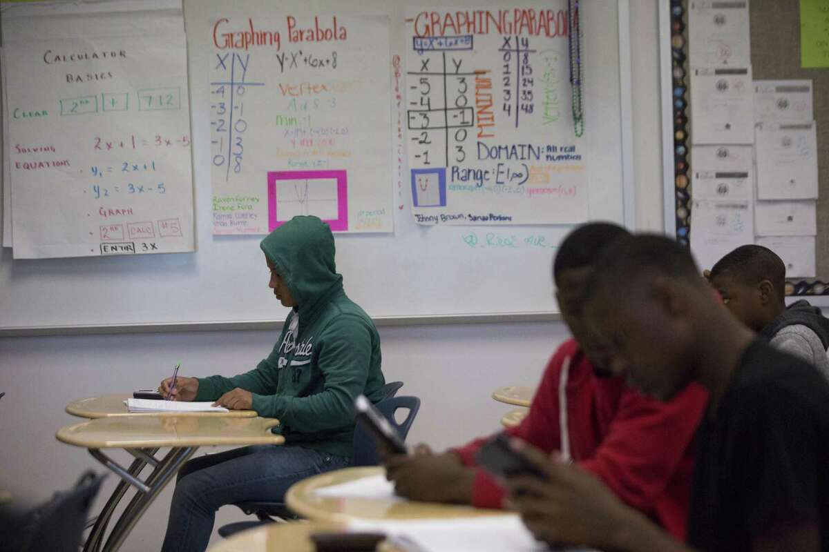 Freshman students at Worthing High School, an Achieve 180 school, work during an Algebra I class, Thursday, April 5, 2018, in Houston. (Marie D. De Jesus / Houston Chronicle)