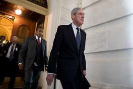 Former FBI Director Robert Mueller, front, the special counsel probing Russian interference in the 2016 U.S. election, leaves the Capitol building after meeting with the Senate Judiciary Committee on Capitol Hill on June 21, 2017 in Washington, D.C. (Ting Shen/Xinhua/Zuma Press/TNS)