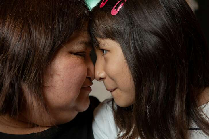 From left: Ximena Rodriguez and her daughter Isabella Rodriguez, 9, at their home on Tuesday, Dec. 4, 2018, in San Ramon, Calif. Ximena said they love to touch noses and play eye stares.