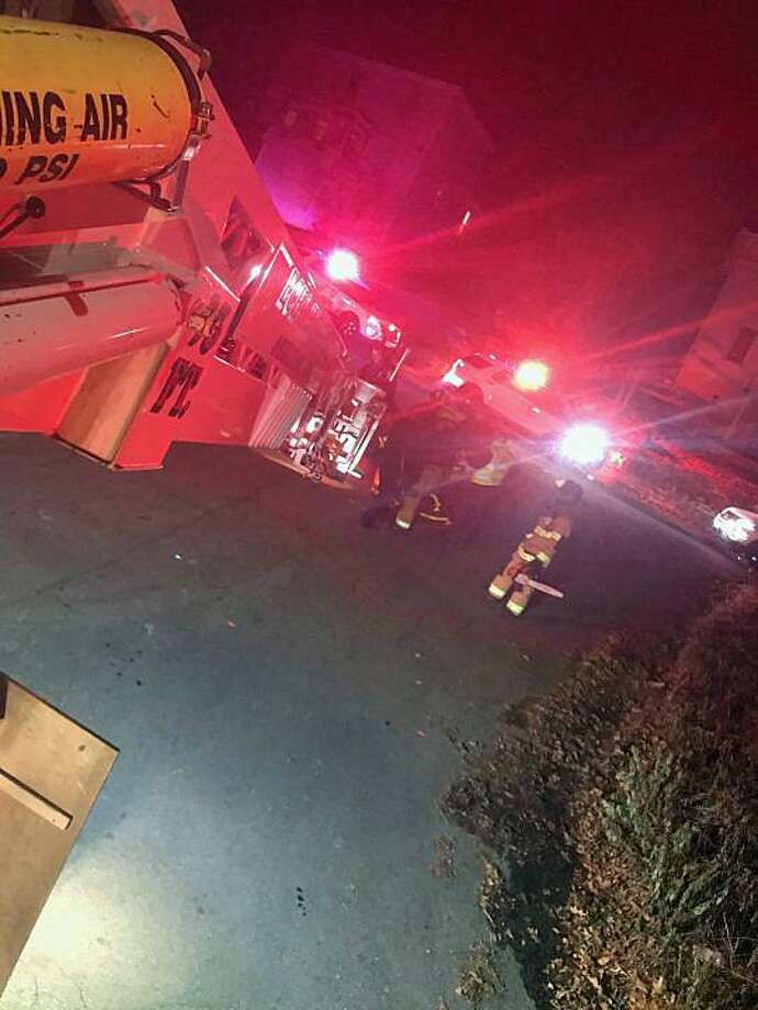 Around 4:30 p.m. Wednesday, Dec. 5, 2018, Shelton, Conn., fire units were sent to Grove Street near its intersection with Laurel Avenue for a report of someone in need of rescuing from a roof. Photo: Contributed Photo / Shelton Echo Hose Fire Company / Contributed Photo / Connecticut Post Contributed