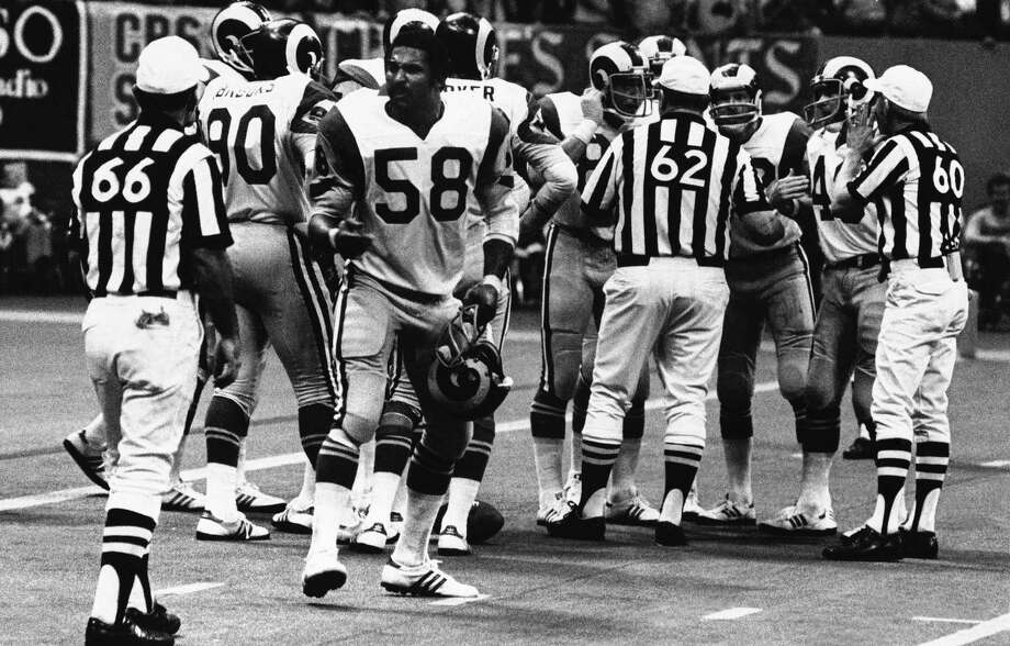 FILE - In this Oct. 30, 1977, file photo, Los Angeles Rams linebacker Isiah Robertson (58) complains about a call during an NFL football game against the New Orleans Saints in New Orleans. Former two-time All-Pro linebacker Robertson was killed when the limousine he was driving skidded on a rain-slicked curve on a dark, rural East Texas highway and was hit by two other vehicles. The Texas Department of Public Safety reports the crash happened Thursday, Dec. 6, 2018. Photo: File, AP / Copyright 2018 The Associated Press. All rights reserved.