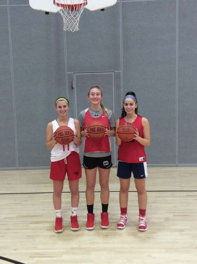 From left to right: Jordan Moses, Taylor Stamos and Michelle Morganti are captains of the Greenwich High School girls basketball team, which opens its season Wednesday at Trinity Catholic. Photo: David Fierro / Hearst Connecticut Media