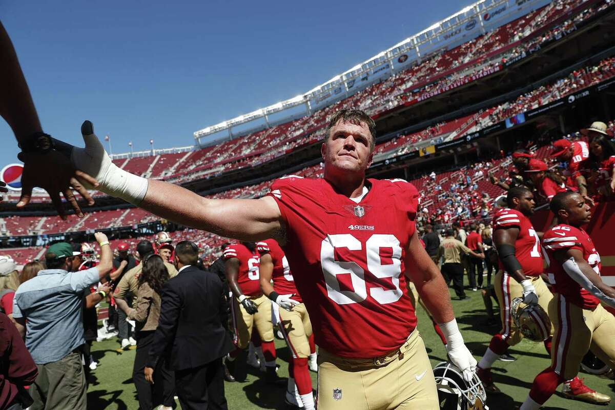 San Francisco 49ers offensive tackle Mike McGlinchey (69) is greeted by fans before an NFL football game against the Detroit Lions in Santa Clara, Calif., Sunday, Sept. 16, 2018. (AP Photo/Tony Avelar)