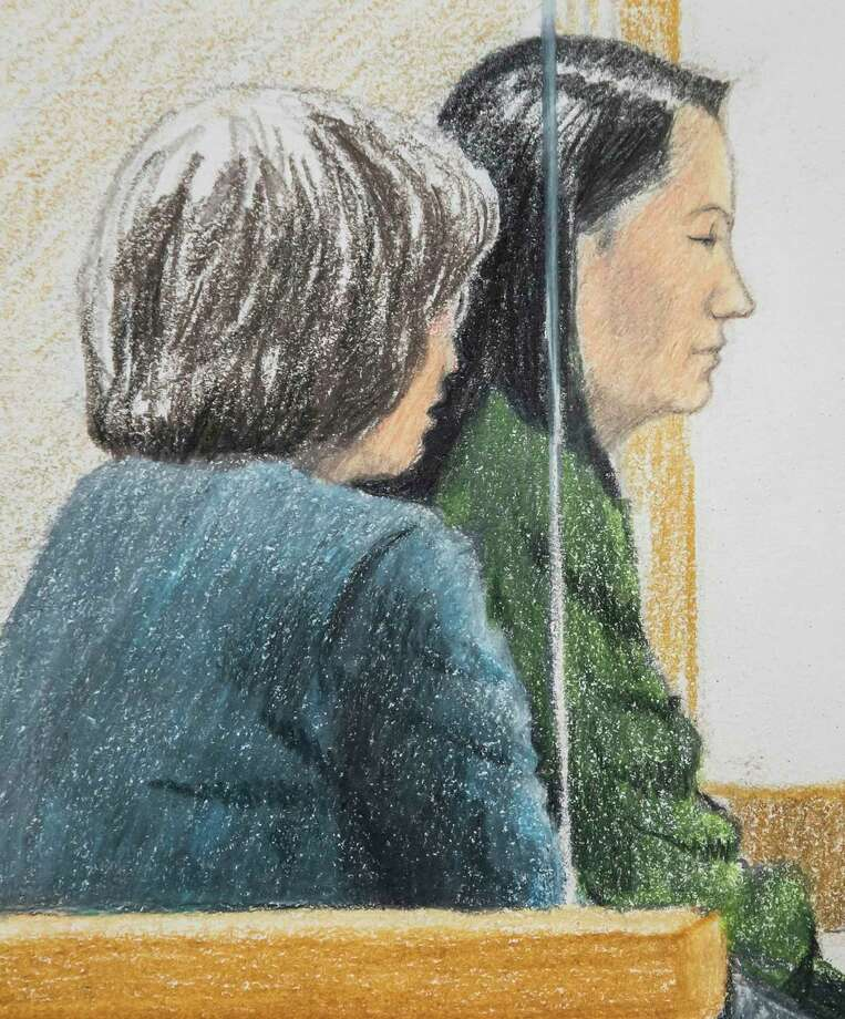 In this courtroom sketch, Meng Wanzhou, right, the chief financial officer of Huawei Technologies, sits beside a translator during a bail hearing at British Columbia Supreme Court in Vancouver, on Friday, Dec.  7, 2018.  Meng faces extradition to the U.S. on charges of trying to evade U.S. sanctions on Iran. She appeared in a Vancouver court Friday to seek bail.  (Jane Wolsak/The Canadian Press via AP) Photo: Jane Wolsak / The Canadian Press