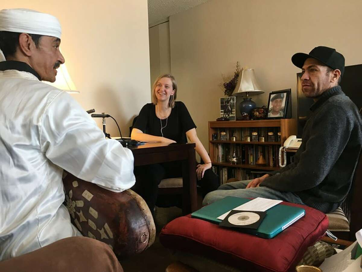 Photo by Diane Duggan Left to right, Hassan Ben Jaafar of the musical group Innov Gnawa, Liz H. Strong and Karim Ababou record an oral history interview in February 2018 about Ben Jaafar?s music and his life in Brooklyn.
