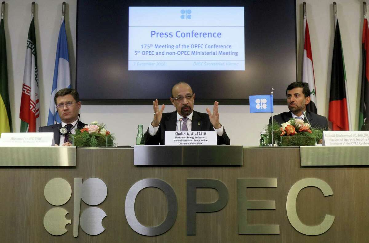 Russian Minister of Energy Alexander Novak, Khalid Al-Falih, Minister of Energy, Industry and Mineral Resources of Saudi Arabia and Minister of Energy of the United Arab Emirates, UAE, Suhail Mohamed Al Mazrouei, from left, attend a news conference after a meeting of the Organization of the Petroleum Exporting Countries, OPEC, and non OPEC members, at their headquarters in Vienna, Austria, Austria, Friday, Dec. 7, 2018. NEXT: Which countries are members of OPEC?