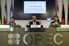 Russian Minister of Energy Alexander Novak, Khalid Al-Falih, Minister of Energy, Industry and Mineral Resources of Saudi Arabia and Minister of Energy of the United Arab Emirates, UAE, Suhail Mohamed Al Mazrouei, from left, attend a news conference after a meeting of the Organization of the Petroleum Exporting Countries, OPEC, and non OPEC members, at their headquarters in Vienna, Austria, Austria, Friday, Dec. 7, 2018. (AP Photo/Ronald Zak)