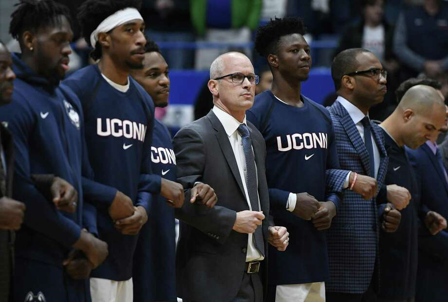 UConn coach Dan Hurley stands with players during the national anthem before Sunday's game against Arizona. Photo: Jessica Hill / Associated Press / Copyright 2018 The Associated Press. All rights reserved