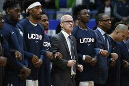UConn coach Dan Hurley stands with players during the national anthem before Sunday's game against Arizona.