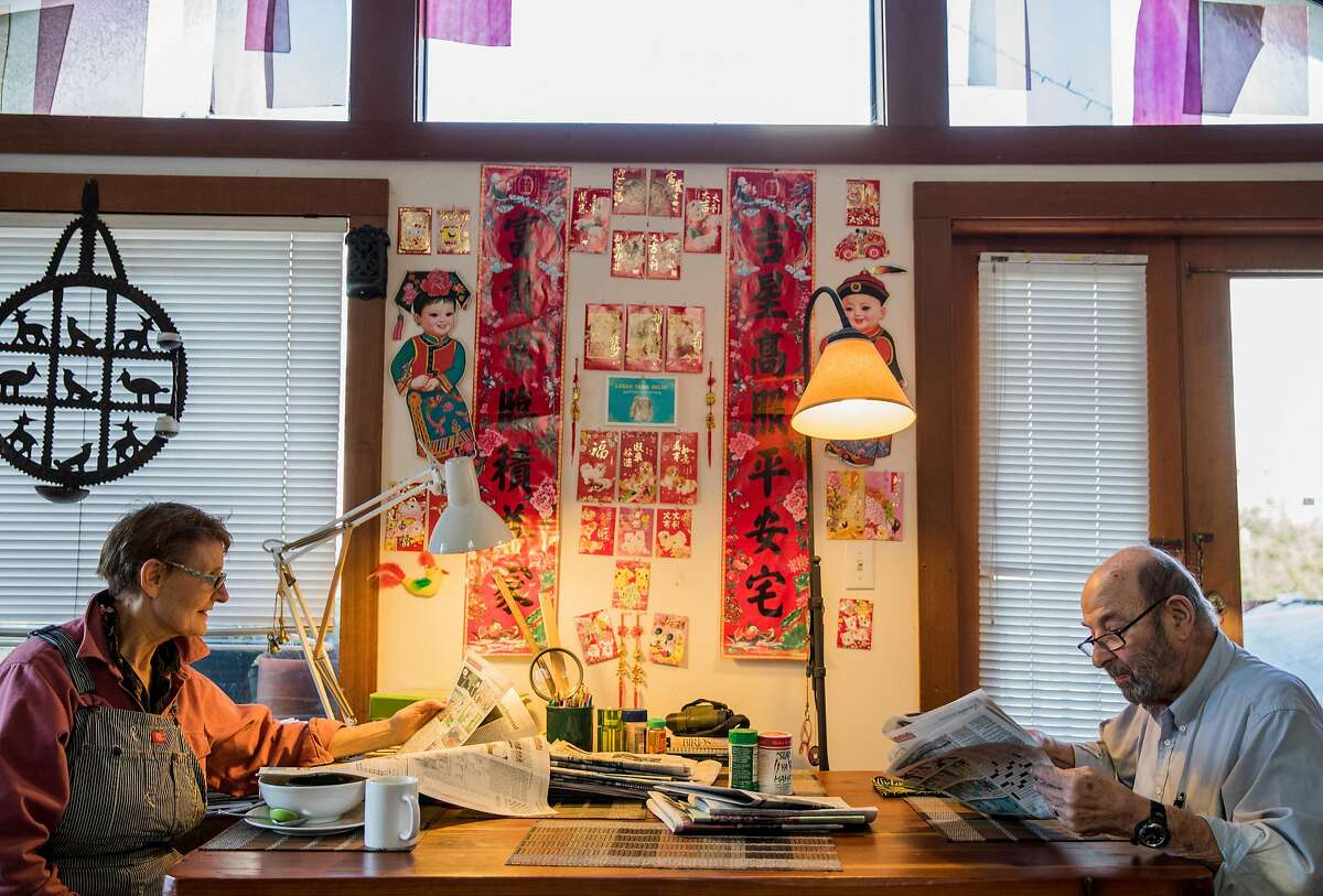 Bob Isaacson (right) and Ginny Stearns enjoy breakfast while reading the paper inside their floating home in the Mission Creek Harbor community in San Francisco, Calif. on Friday, Dec. 7, 2018.