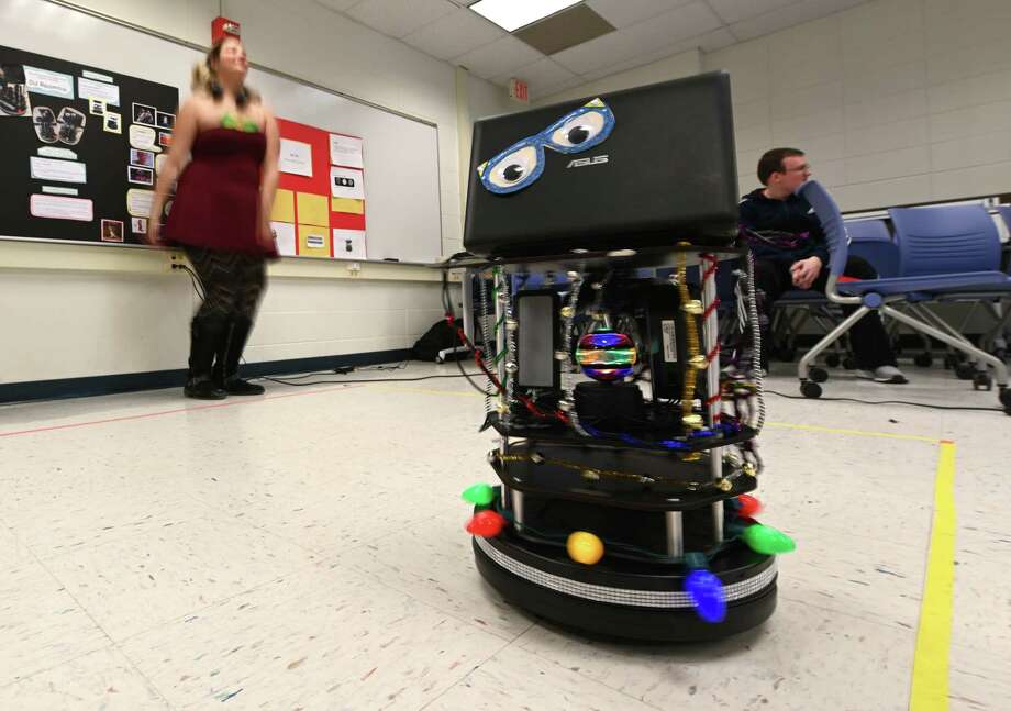 D J Roomba the robot does his thing which is playing music and dancing during the Robo Show held at Siena College Friday Dec. 7, 2018 in Loudonville, N.Y. D J Roomba was constructed by Brooke Hossley and Logan Brandt for the school project in robotics.   (Skip Dickstein/Times Union) Photo: SKIP DICKSTEIN / 20045665A