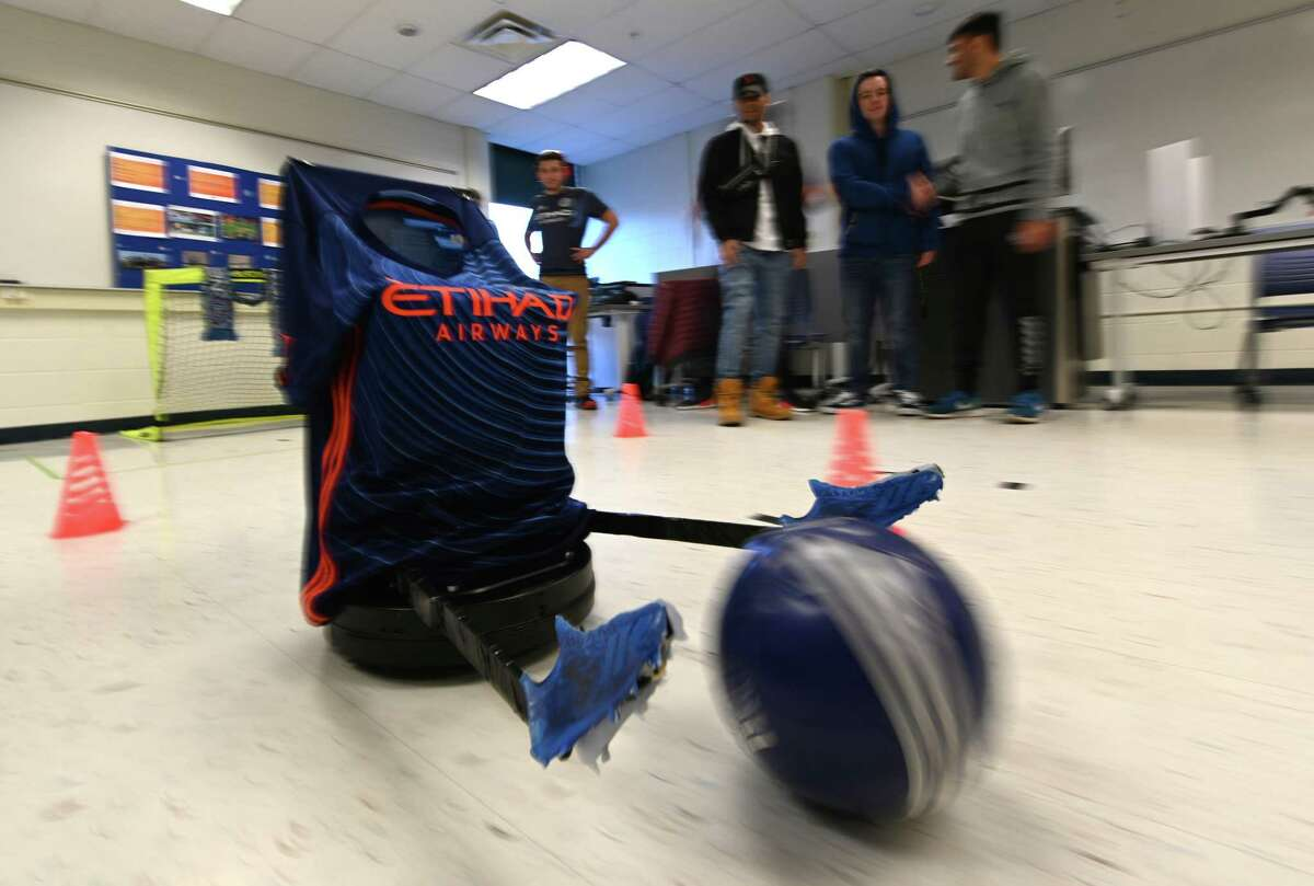 Robotinho makes some soccer moves during the Robo Show held at Siena College Friday Dec. 7, 2018 in Loudonville, N.Y. Robotinho was constructed by Zach Ballard, Abdul Samad and Devante Sanger for their school project in robotics. (Skip Dickstein/Times Union)