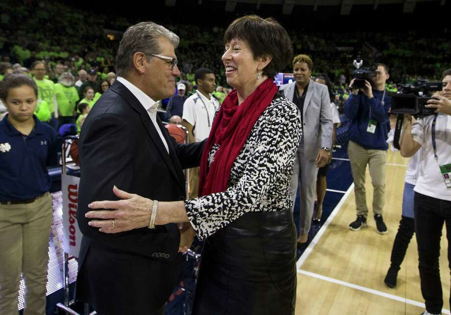 UConn coach Geno Auriemma, left, and Notre Dame's Muffet McGraw shakes hands before Sunday's game in South Bend, Ind. UConn won 89-71. Photo: Robert Franklin / Associated Press / FR17139 AP