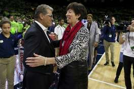 UConn coach Geno Auriemma, left, and Notre Dame's Muffet McGraw shakes hands before Sunday's game in South Bend, Ind. UConn won 89-71.
