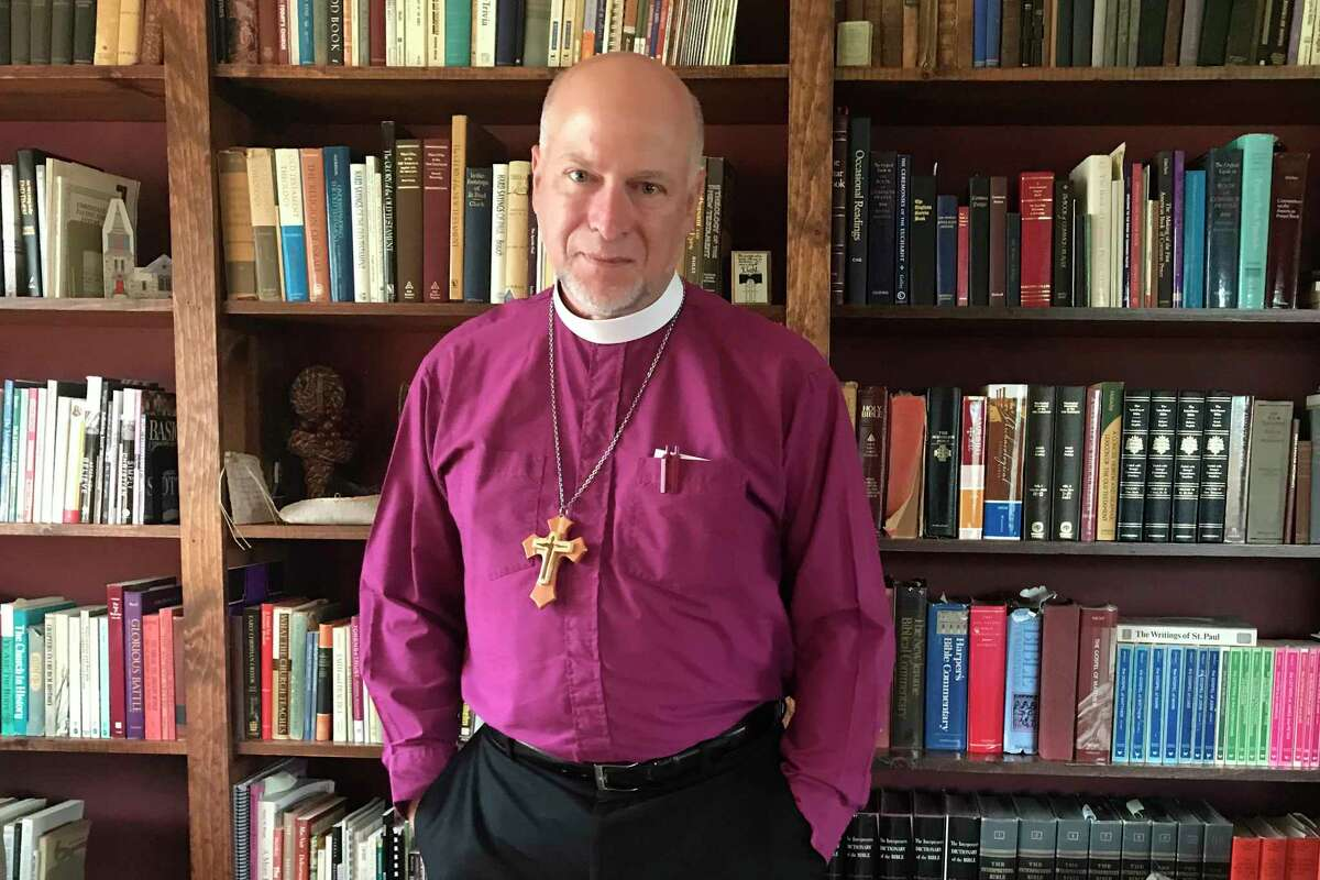 In this Aug. 17, 2018 photo, Bishop William Love poses for a portrait in his office in Greenwich, N.Y. Love, the bishop of the Albany, New York, Episcopal Diocese on Saturday, Nov. 10, 2018, issued a directive banning same-sex marriages in the diocese, saying that the church has been