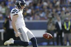 Seattle Seahawks punter Michael Dickson (4) punts the ball downfield during the first half in an NFL football game against the Los Angeles Rams Sunday, Nov. 11, 2018, in Los Angeles. (AP Photo/Alex Gallardo)