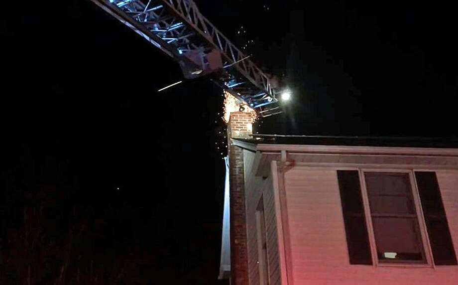 On Dec. 7, 2018, Fairfield, Conn., fire units rushed to a home in the Stratfield section of town for a report of a possible chimney fire. Photo: Contributed Photo / Fairfield Fire Department / Contributed Photo / Connecticut Post Contributed