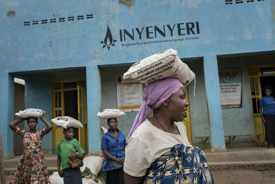 Mukamurenzi Anasthasie leaves an Inyenyeri store with a bag of wood pellets for her stove from the company in Rwanda. Photo: Photos By Diana Zeyneb Alhindawi / New York Times