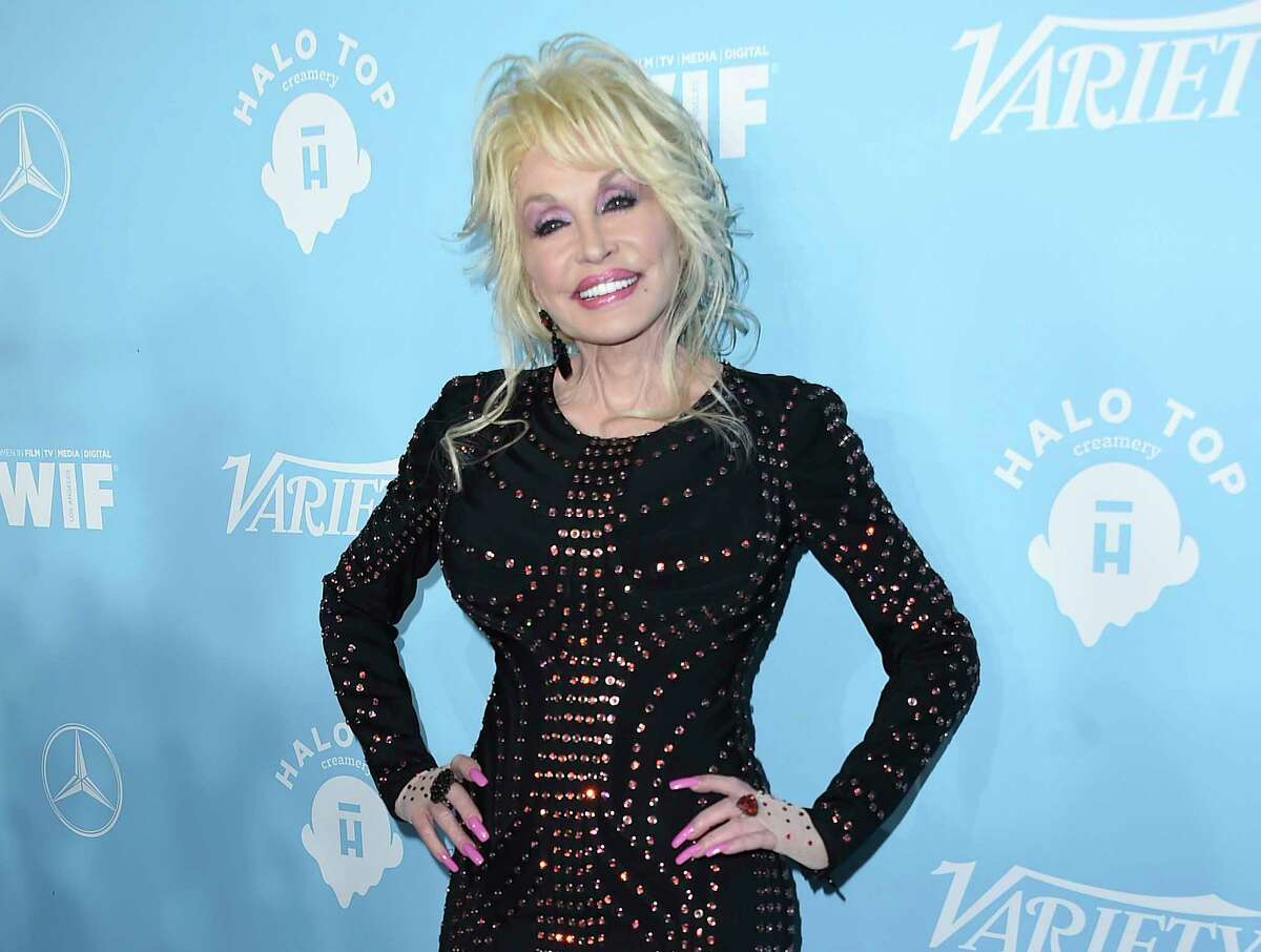 """FILE - In this Sept. 15, 2017 file photo, Dolly Parton arrives at the 69th Primetime Emmy Awards Variety and Women in Film pre-Emmy celebration in Los Angeles. Parton on Thursday, Dec. 6, 2018, was nominated for a Golden Globe for """"The Girl in the Movies,"""" which she co-wrote with Linda Perry. (Photo by Jordan Strauss/Invision/AP, File)"""