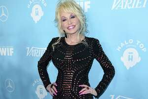 """FILE - In this Sept. 15, 2017 file photo, Dolly Parton arrives at the 69th Primetime Emmy Awards Variety and Women in Film pre-Emmy celebration in Los Angeles. Parton on Thursday, Dec. 6, 2018,  was nominated for a Golden Globe for """"The Girl in the Movies,"""" which she co-wrote with Linda Perry.(Photo by Jordan Strauss/Invision/AP, File)"""