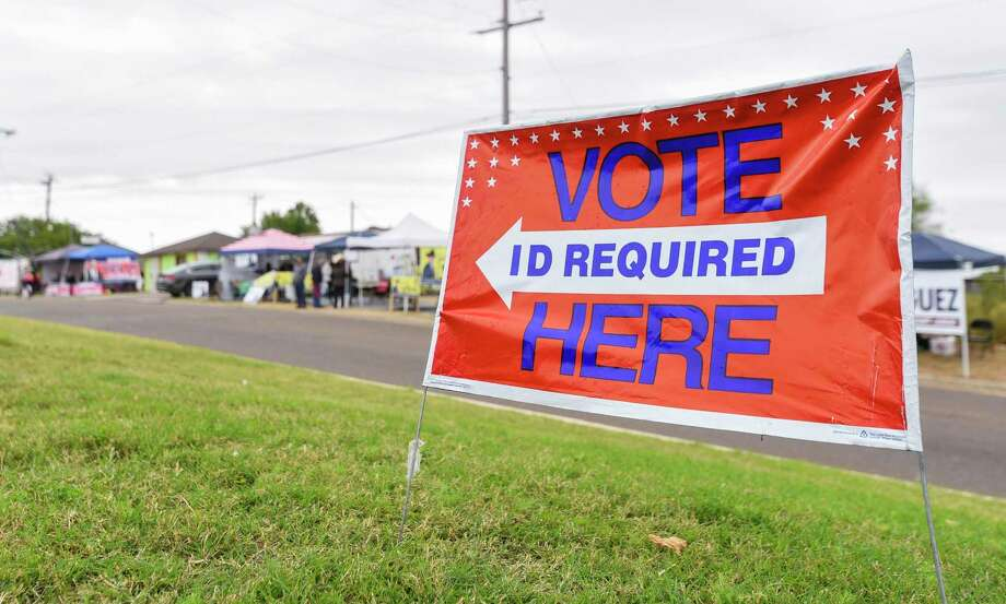 Supporters of local candidates setup outside the Sophie Christen McKendrick Francisco Ochoa Fernando A. Salinas Branch Library on Monday, Dec. 3, 2018, as early voting begins for run-off elections. The branch library is one of five permanent early voting sites. Photo: Danny Zaragoza /Laredo Morning Times