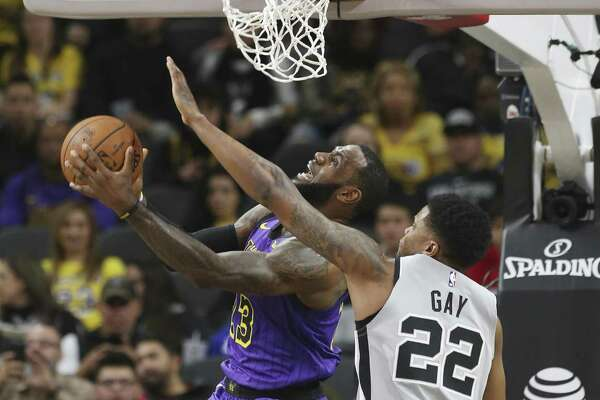 Spurs' Rudy Gay (22) defends against Los Angeles Lakers' LeBron James (23) at the AT&T Center on Friday, Dec. 7, 2018. (Kin Man Hui/San Antonio Express-News)