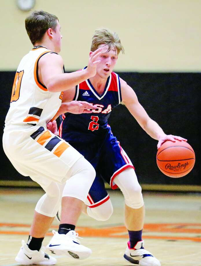 Tyler Heckroth drives to the basket Friday night in USA's 59-44 victory over Harbor Beach. Heckroth scored a career-high 30 points to lead the Patriots to the win. Photo: Mike Gallagher/Huron Daily Tribune
