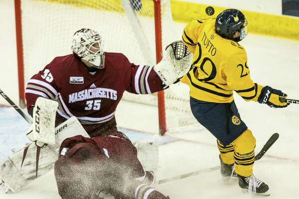 UMass goaltender Filip Lindberg makes a save on a shot by Odeen Tufto during Quinnipiac's 4-0 win on Friday night in Hamden.