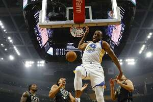Golden State Warriors' Andre Iguodala dunks during the first half of an NBA basketball game against the Milwaukee Bucks Friday, Dec. 7, 2018, in Milwaukee. (AP Photo/Morry Gash)