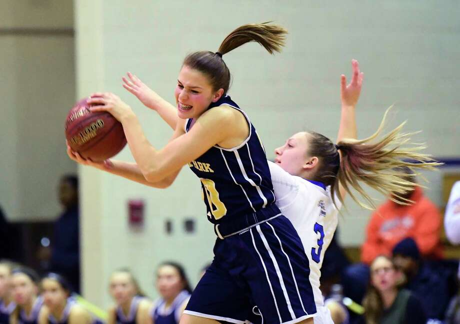 Averill Park's Anna Jankovic (10) grabs a pass in front of Albany's Jenna Citone (3) during the first half of a girls high school basketball game Friday, Dec. 7, 2018, in Albany, N.Y. (Hans Pennink / Special to the Times Union) Photo: Hans Pennink / Hans Pennink