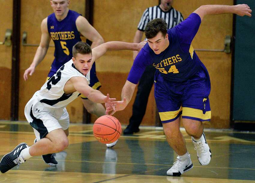 Shen's #32 Jake Reinisch, left, and CBAOs #54 Drew Signor chase a loose ball during Friday night's game Dec. 7, 2018 in Clifton Park, NY. (John Carl D'Annibale/Times Union)