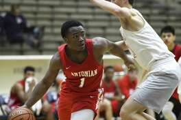 Chance Felix of Antonian drives against Belton during the San Antonio Independent School District boys basketball tournament at the Alamo Convocation Center on Friday, Dec. 7, 2018.