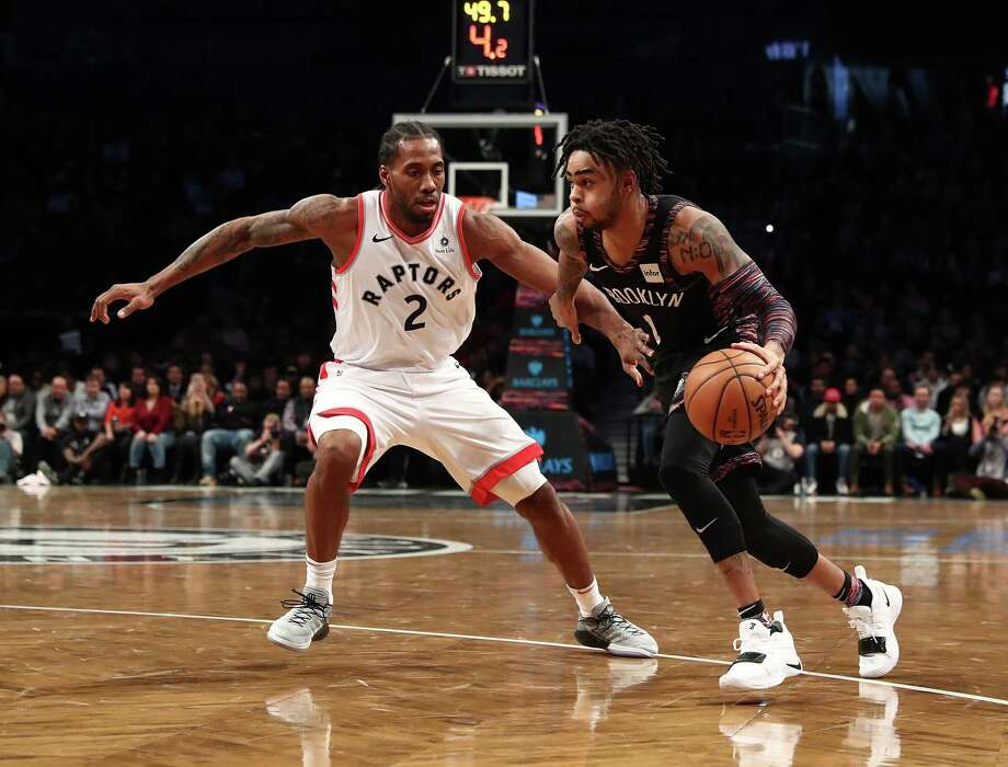 NEW YORK, NEW YORK - DECEMBER 07: D'Angelo Russell #1 of the Brooklyn Nets drives against Kawhi Leonard #2 of the Toronto Raptorsduring their game at the Barclays Center on December 07, 2018 in New York City. (Photo by Al Bello/Getty Images) Photo: Al Bello / 2018 Getty Images
