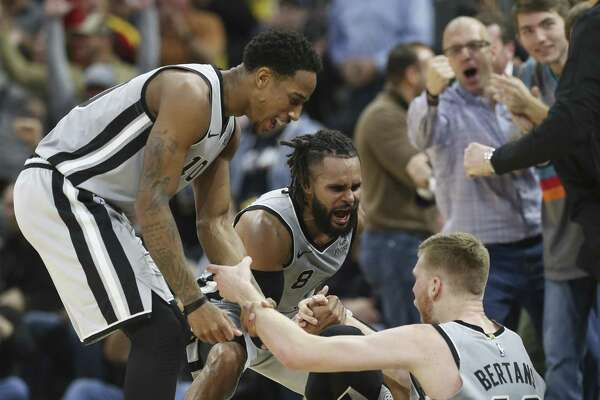 """Davis Bertans is happy DeMar DeRozan, left, is expected back in the lineup tonight: """"He's assisted on plenty of my 3-point shots."""""""