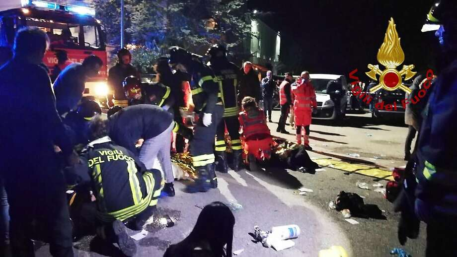 This handout picture taken and released by Vigili del Fuoco, the Italian fire and rescue service, on December 8, 2018 shows emergency personnel treating victims after a stampede at a nightclub in Cornaldo. - Six people died in a stampede at a nightclub in central Italy after panic erupted in the early hours of December 8 morning, firefighters said.  Photo: HANDOUT, AFP/Getty Images
