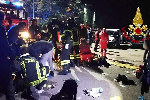 """This handout picture taken and released by Vigili del Fuoco, the Italian fire and rescue service, on December 8, 2018 shows emergency personnel treating victims after a stampede at a nightclub in Cornaldo. - Six people died in a stampede at a nightclub in central Italy after panic erupted in the early hours of December 8 morning, firefighters said. (Photo by Handout / Vigili del Fuoco / AFP) / RESTRICTED TO EDITORIAL USE - MANDATORY CREDIT """"AFP PHOTO / Vigili del Fuoco"""" - NO MARKETING NO ADVERTISING CAMPAIGNS - DISTRIBUTED AS A SERVICE TO CLIENTSHANDOUT/AFP/Getty Images"""