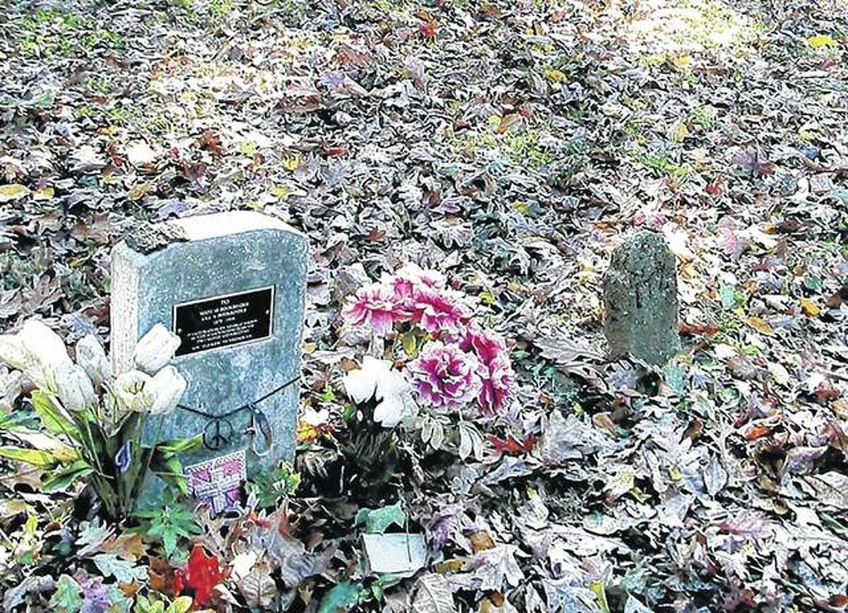 """A modern tombstone memorializes A. Bookbinder amid rows of markers at the former Peoria State Hospital in Bartonville. The asylum resident, who died in 1910, was known for weeping at every funeral. His original stone was swiped decades ago, but a retired worker installed the new marker in 2006. It reads in part, """"In each death he found great sorrow. He wept at each, passing tears for the unloved and forgotten. Now, 'Old Book,' we weep for you."""""""