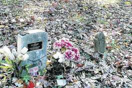 "A modern tombstone memorializes A. Bookbinder amid rows of markers at the former Peoria State Hospital in Bartonville. The asylum resident, who died in 1910, was known for weeping at every funeral. His original stone was swiped decades ago, but a retired worker installed the new marker in 2006. It reads in part, ""In each death he found great sorrow. He wept at each, passing tears for the unloved and forgotten. Now, 'Old Book,' we weep for you."""