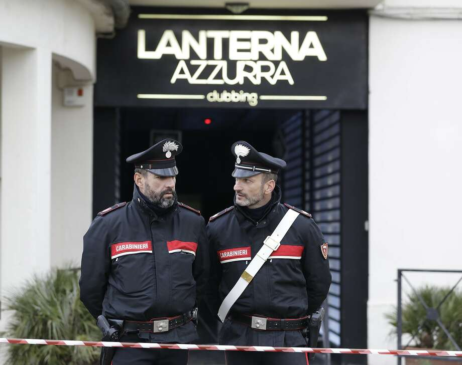 Police stand outside the nightclub in Corinaldo where six people were killed in a stampede. Photo: Andrew Medichini / Associated Press