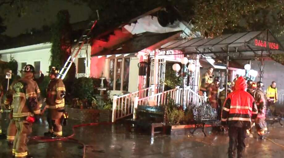 Houston firefighters responded to a blaze about 10 p.m. Friday at the popular Baba Yega Cafe on Grant. The restaurant was closed at the time and there were no injuries. Photo: Metro Video