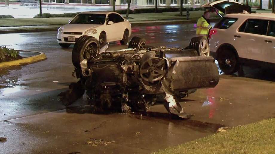 A man died early Saturday morning in Cypress after he lost control of his Chevy Camaro amid heavy rain and struck a light pole, flipping the car on its head, officials said. Photo: Metro Video