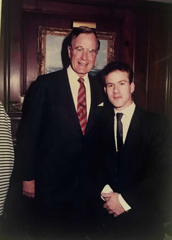 The nation's 41st president, George H.W. Bush, poses with photographer-at-large and musician Bob Capazzo in Greenwich in 1988. Photo: Contributed /