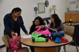 Plainview educators are working to Keep Kids Warm. From left to right: Dalia Pardo, Secretary to the Director for Federal Programs, Edna Garcia, Director for Federal Programs, and Cynthia Isaguirre