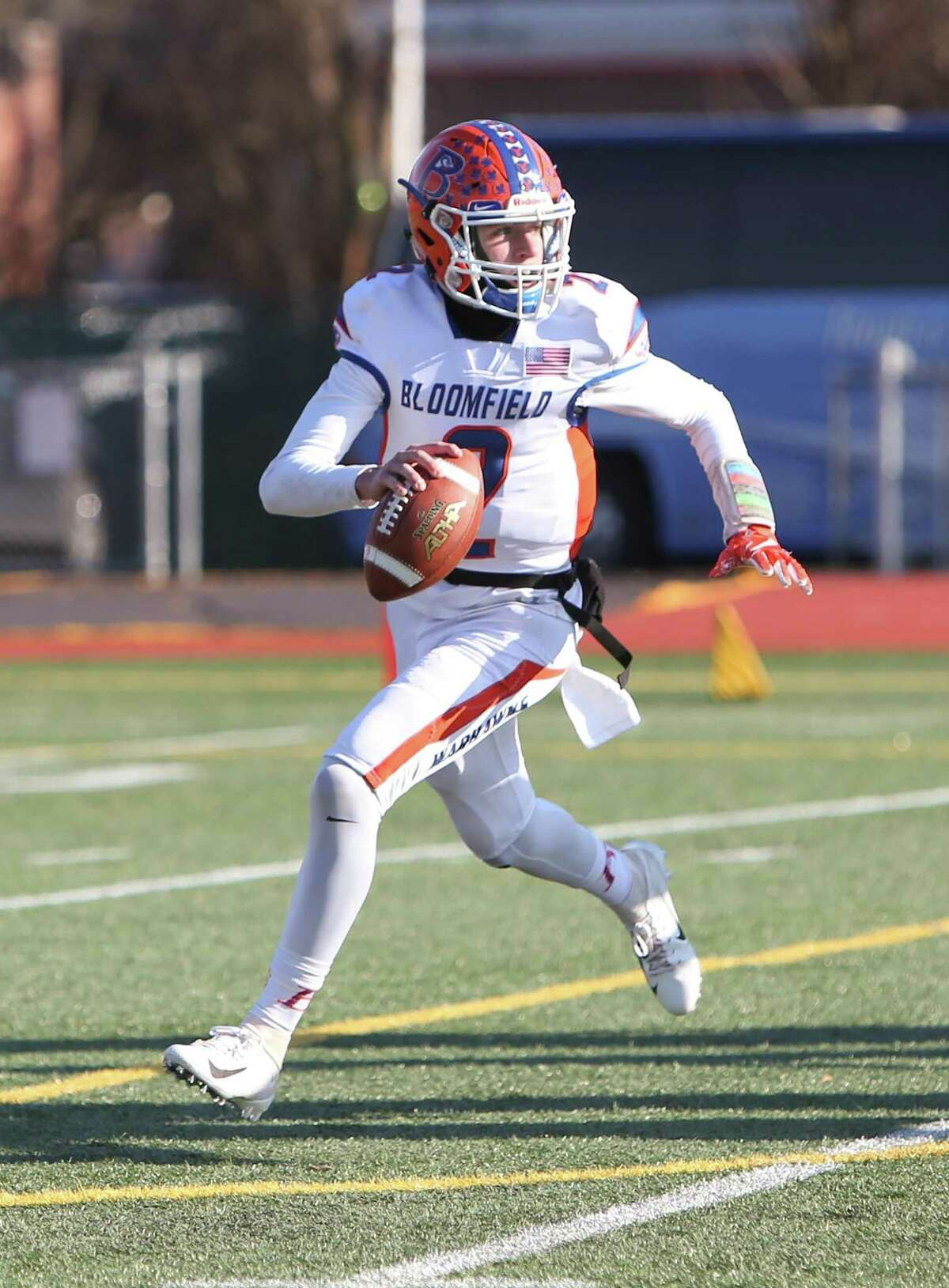 Bloomfield High School quarterback Daron Bryden throws on the move during the Class S Championship Game in New Britain against Haddam-Killingworth High School on Saturday, Dec. 8, 2018.